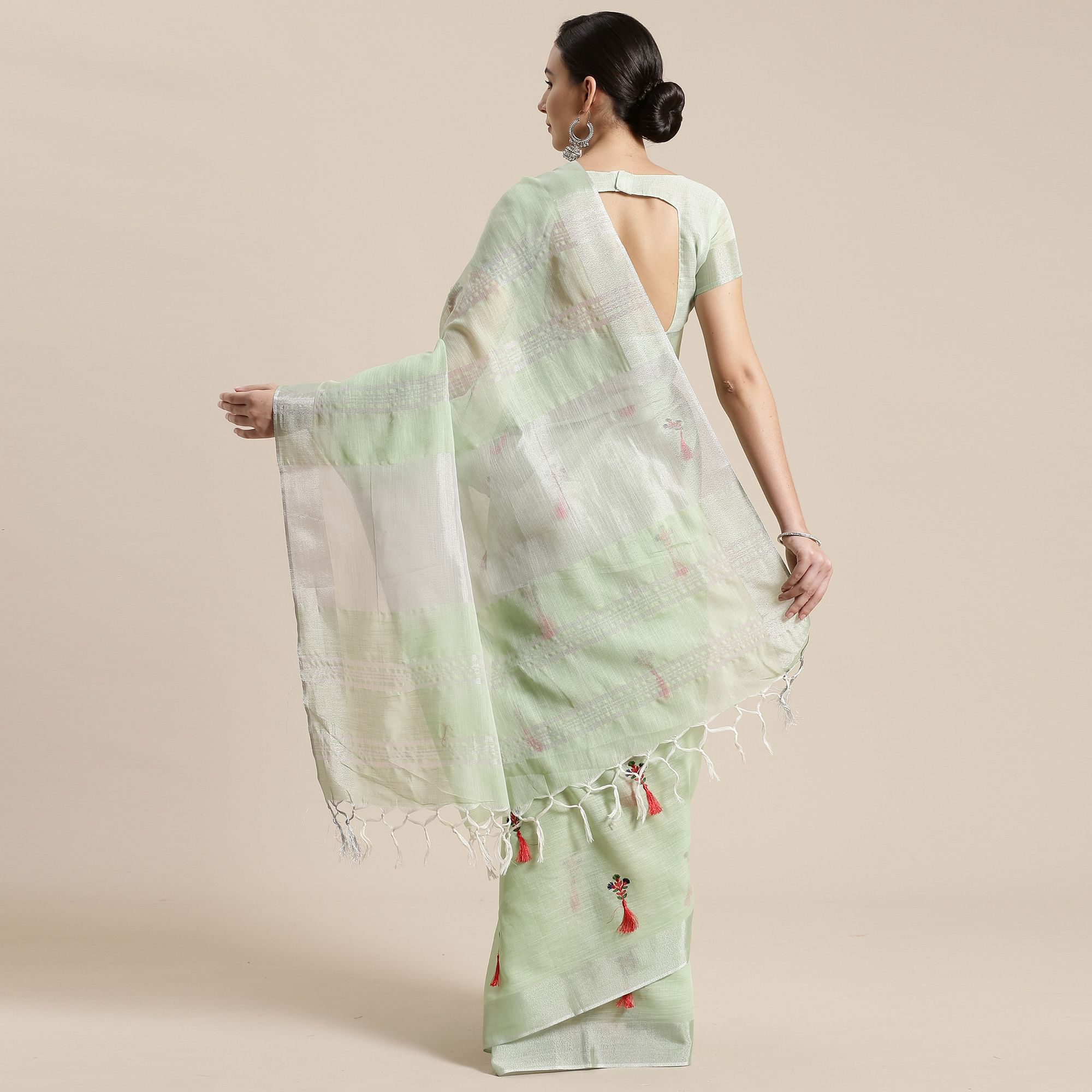 Desirable Light Green Colored Festive Wear Floral Embroidered Linen Blend Saree With Tassels