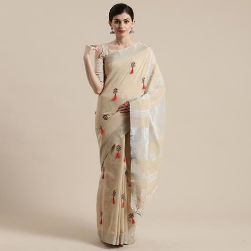 Exotic Beige Colored Festive Wear Floral Embroidered Linen Blend Saree With Tassels
