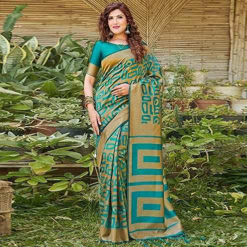 Impressive Teal Blue Colored Festive Wear Floral Woven Silk Blend Saree With Tassels