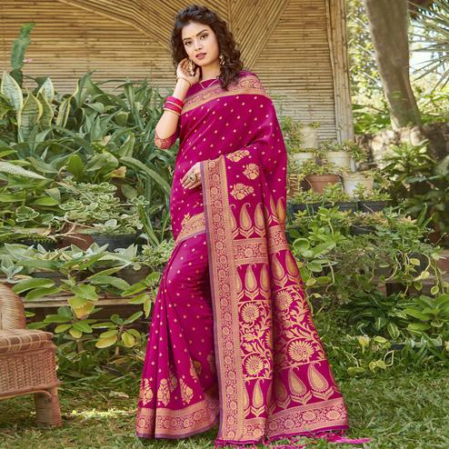 Mesmerising Magenta Pink Colored Festive Wear Floral Woven Silk Blend Saree With Tassels