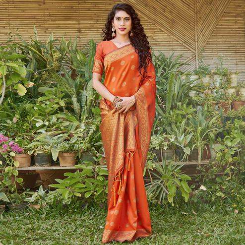 Pleasance Orange Colored Festive Wear Floral Woven Silk Blend Saree With Tassels