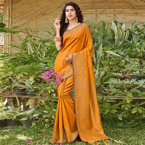 Ethnic Mustard Yellow Colored Festive Wear Floral Woven Silk Blend Saree With Tassels