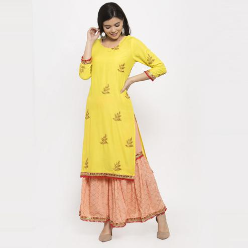 Aujjessa - Yellow Peach Colored Partywear Embroidered Rayon Kurti Sharara Set
