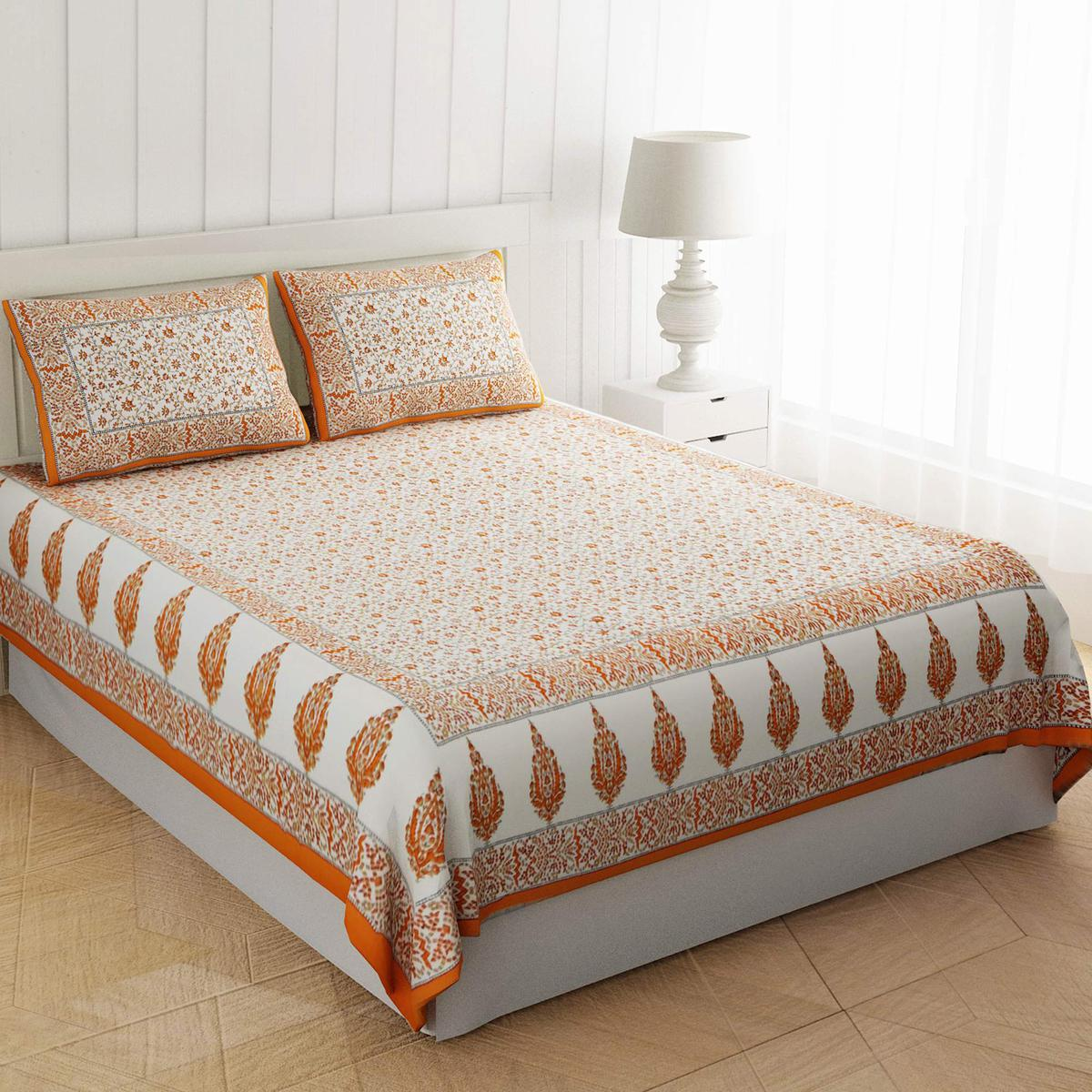 Dazzling Orange Colored Flowery Motif Print Cotton Double Bedsheet With Pillow Cover