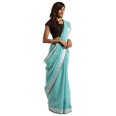Amazing Teal Blue Colored Festive Wear Woven Linen Silk Saree