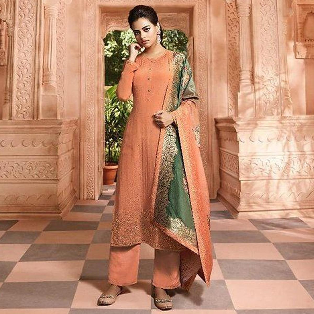 Glowing Orange Colored Partywear Floral Embroidered Satin Crepe Gharara Style Suit