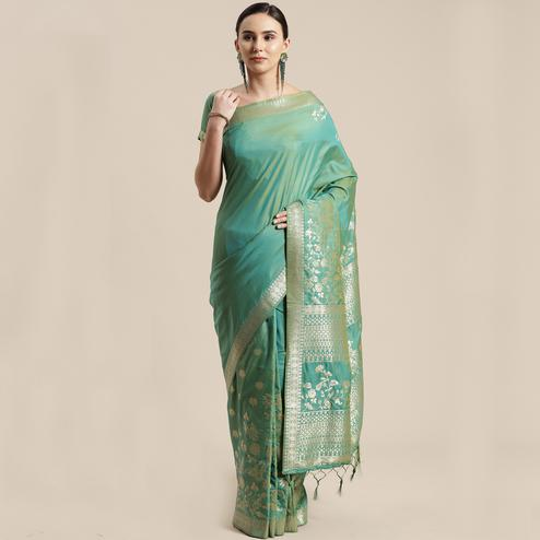 Charming Sea Green Colored Festive Wear Silk Blend Woven Floral Saree With Tassels