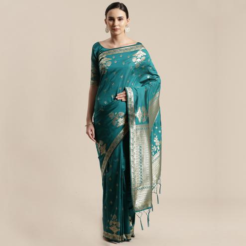 Delightful Teal Green Colored Festive Wear Silk Blend Woven Floral Saree With Tassels