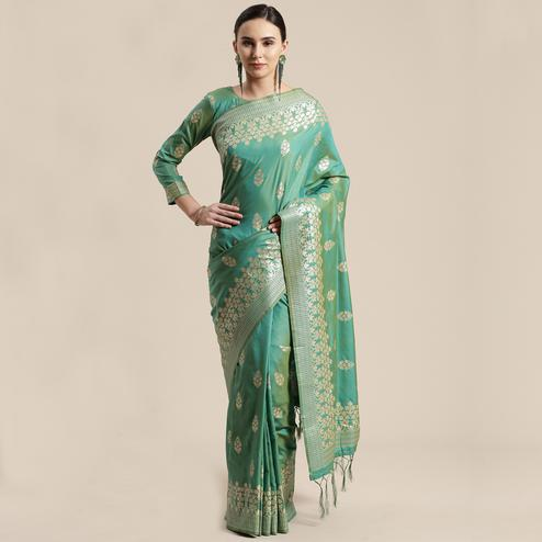 Amazing Sea Green Colored Festive Wear Silk Blend Woven Floral Saree With Tassels