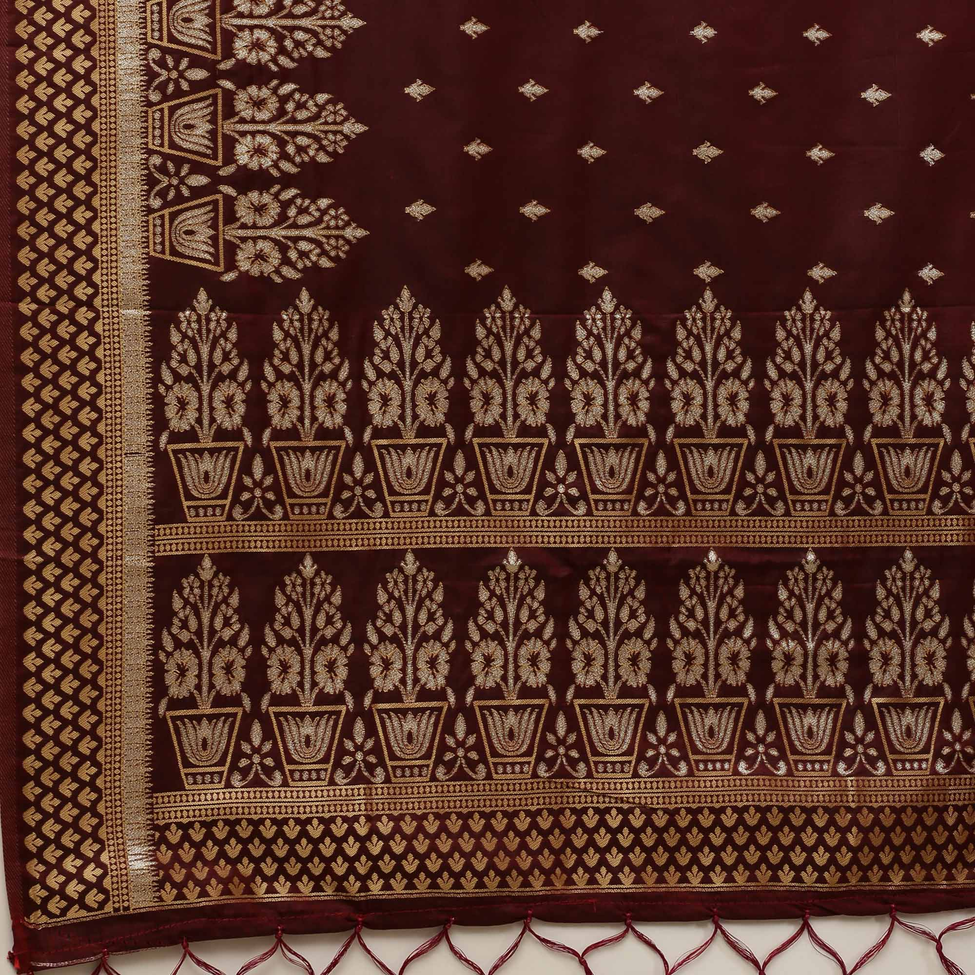 Ideal Brown Colored Festive Wear Silk Blend Woven Floral Saree With Tassels