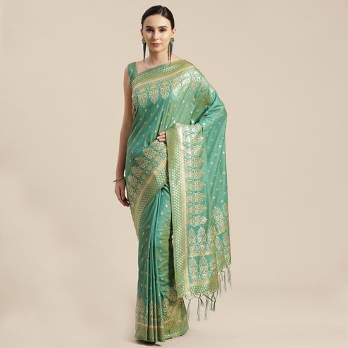 Imposing Sea Green Colored Festive Wear Silk Blend Woven Floral Saree With Tassels