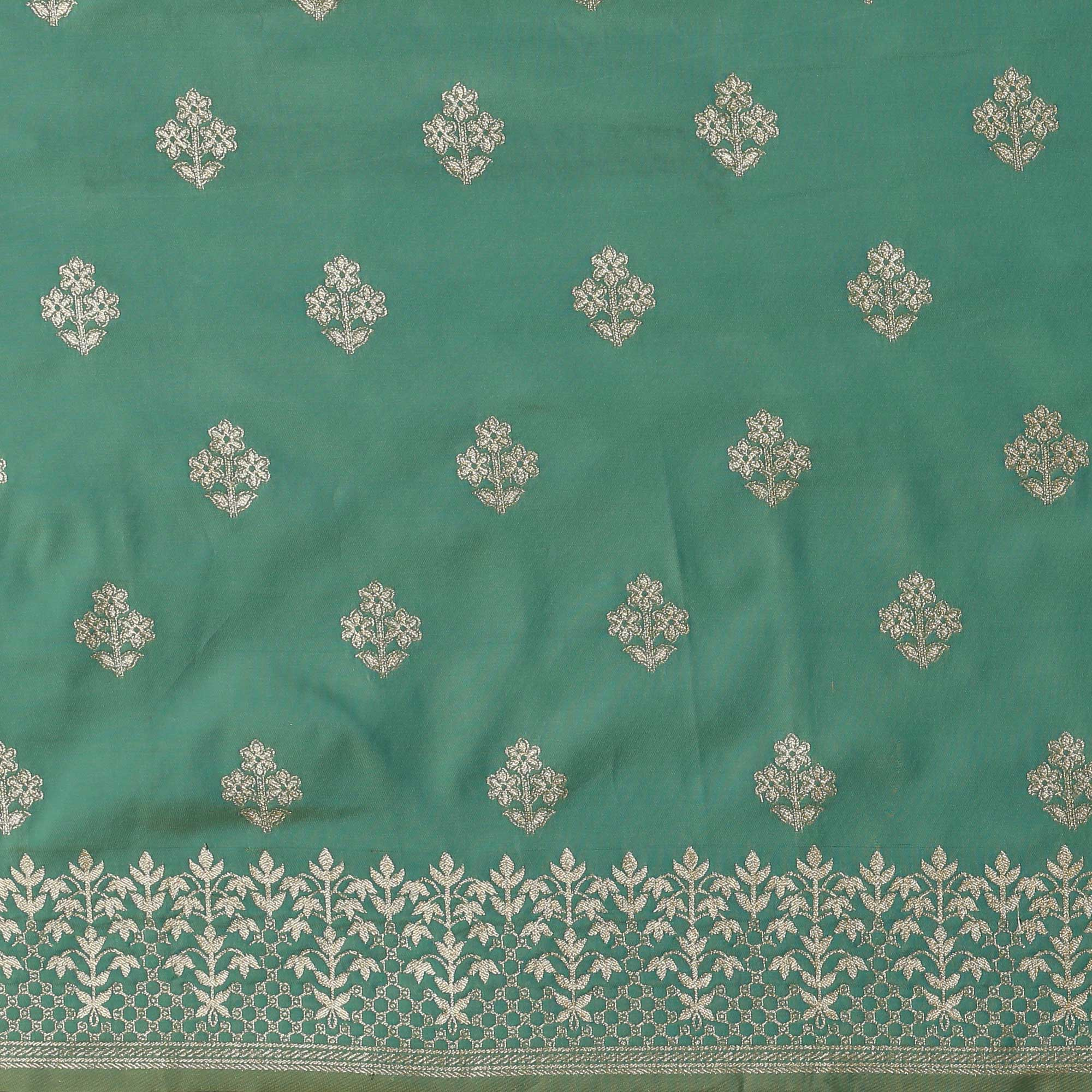 Mesmerising Sea Green Colored Festive Wear Silk Blend Woven Floral Saree With Tassels