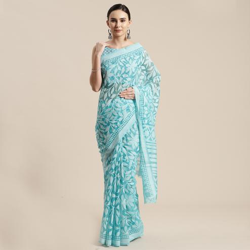 Surpassing Turquoise Colored Party Wear Geometric Brasso Saree