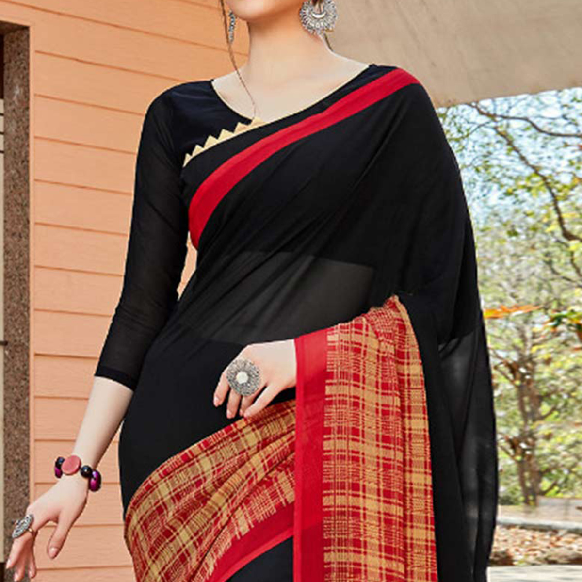 Radiant Black Colored Casual Wear Georgette Saree