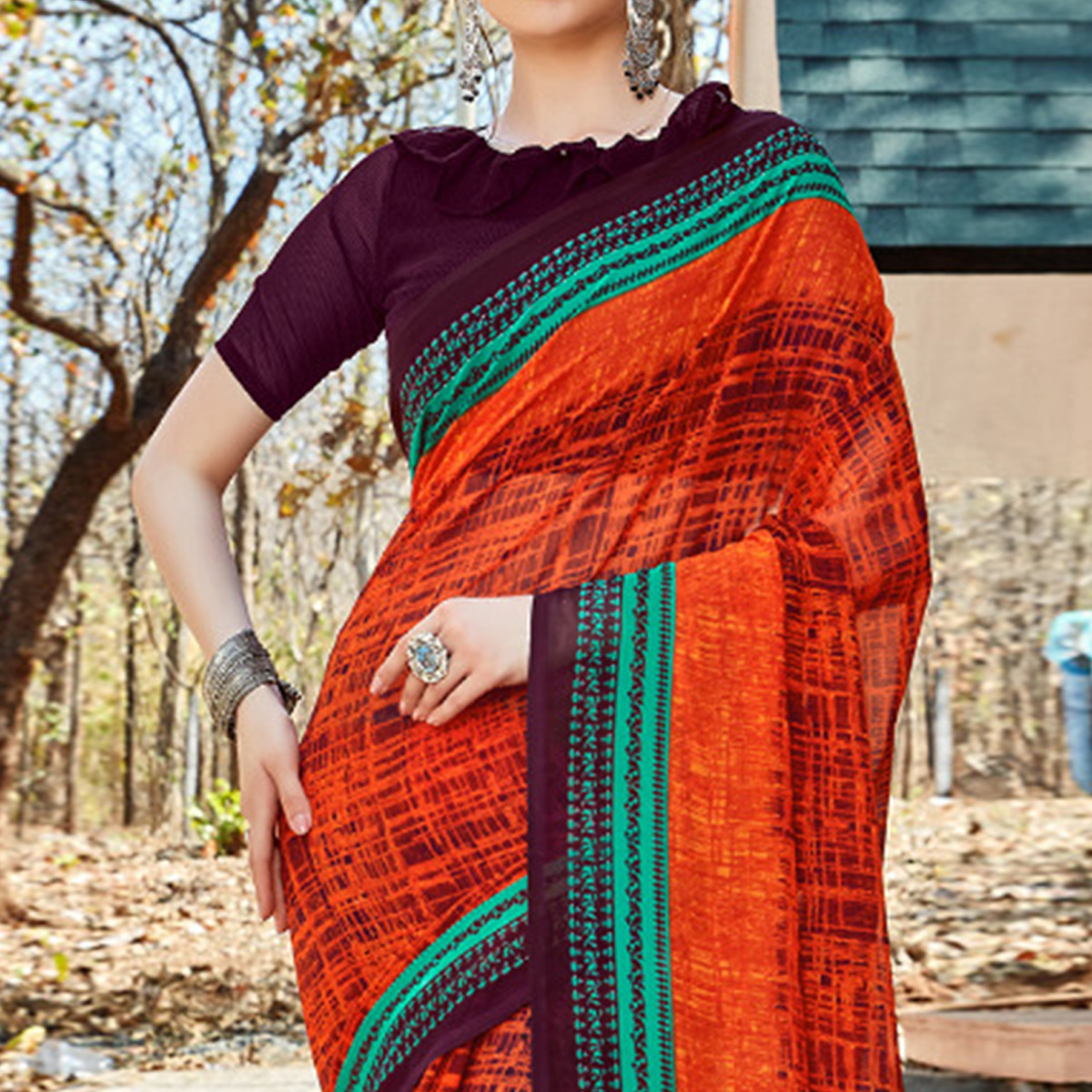 Glowing Orange Colored Casual Wear Georgette Saree