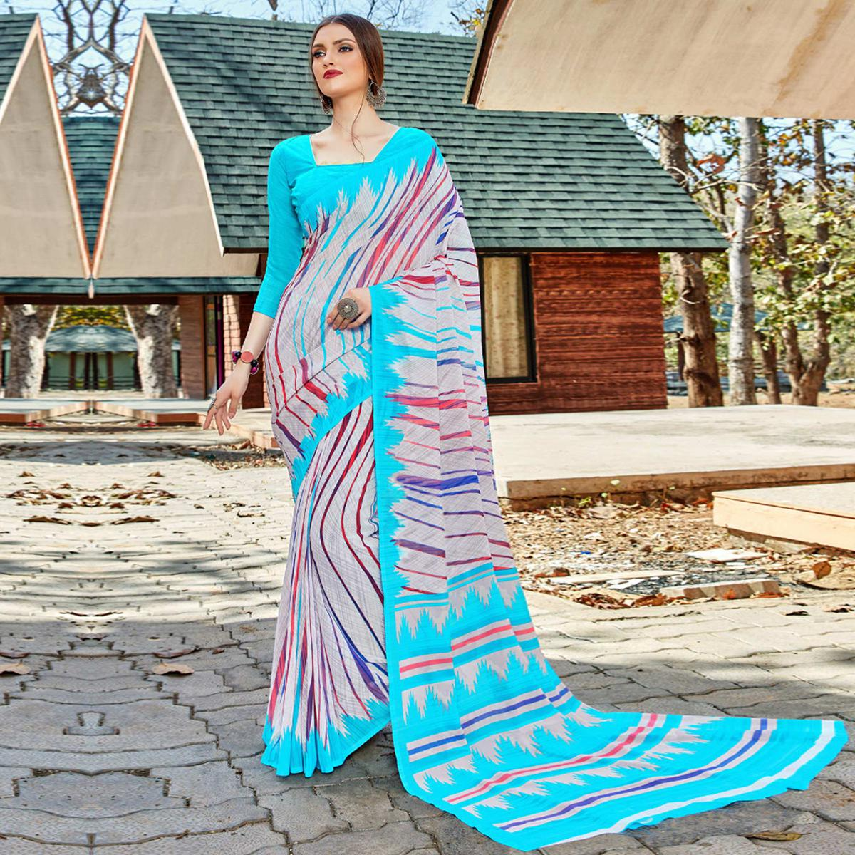 Mesmeric White-Blue Colored Casual Wear Georgette Saree