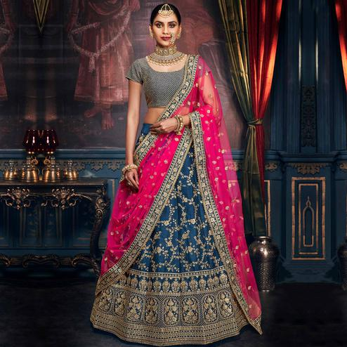 NAKKASHI - Captivating Teal Blue Colored Party Wear Floral Embroidered Handloom Silk Lehenga Choli