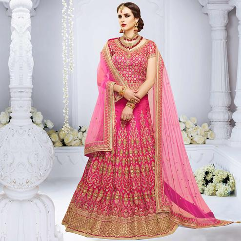 NAKKASHI - Desirable Pink Colored Party Wear Embroidered Crystal Raw Silk Lehenga Choli