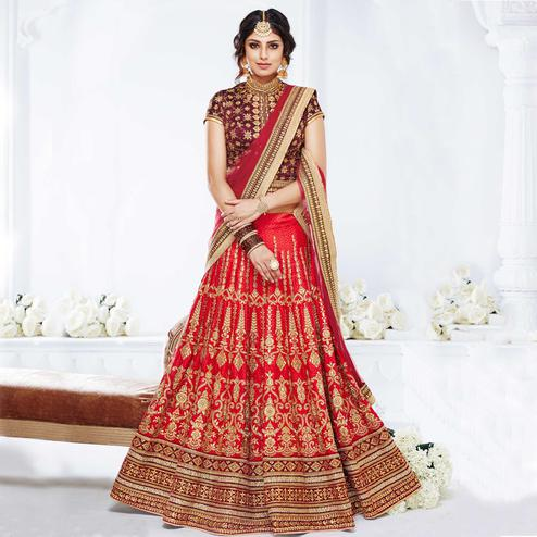 NAKKASHI - Exotic Red Colored Party Wear Embroidered Raw Silk Lehenga Choli