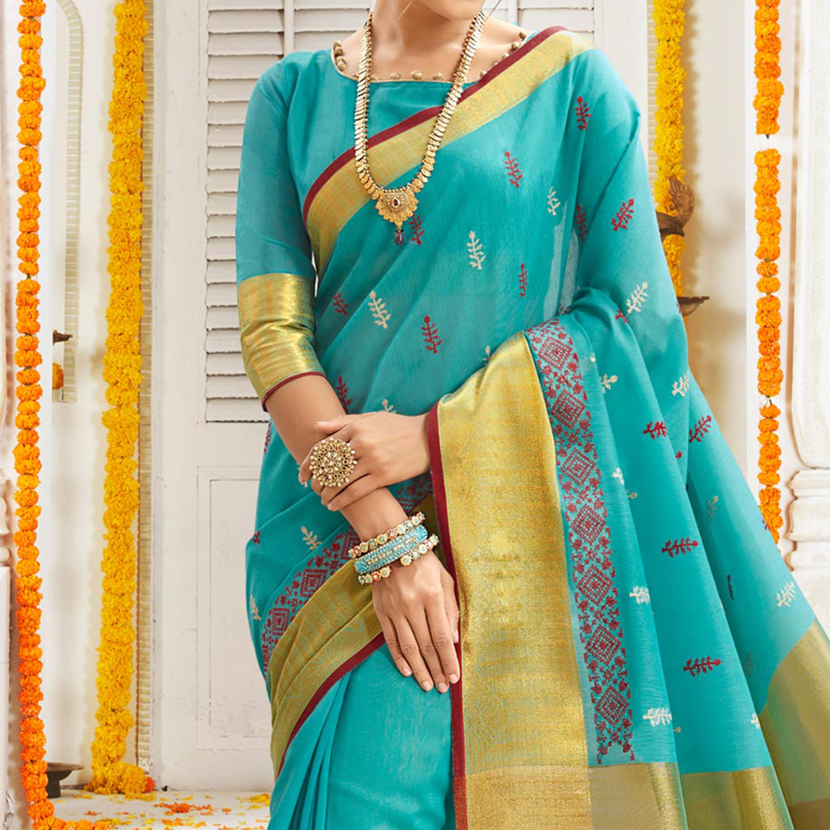 Elegant Turquoise Blue Cotton Silk Embroidered Festive Wear Saree