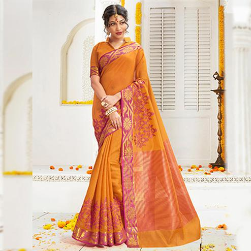 Ravishing Orange Cotton Silk Embroidered Partywear Saree