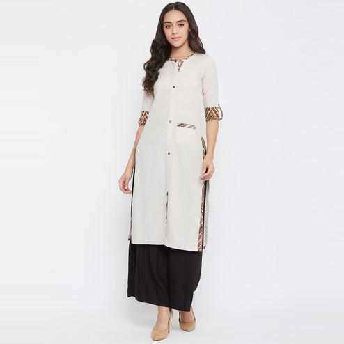Winered - Beige Colored Casual Wear Self Design Cotton Kurti