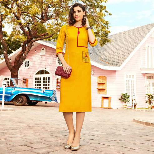 Prominent Yellow Colored Casual Wear Floral Embroidered Swiss Cotton Slub Kurti
