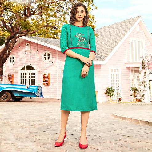 Exotic Turquoise Colored Casual Wear Floral Embroidered Swiss Cotton Slub Kurti