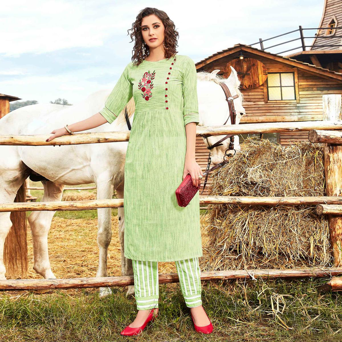 Desirable Green Colored Casual Wear Floral Embroidered Handloom Cotton Linen Kurti-Pant Set