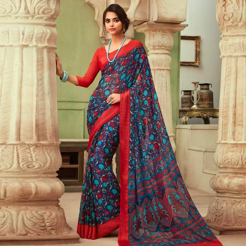 Flattering Blue Colored Casual Wear Floral Printed Chiffon Saree