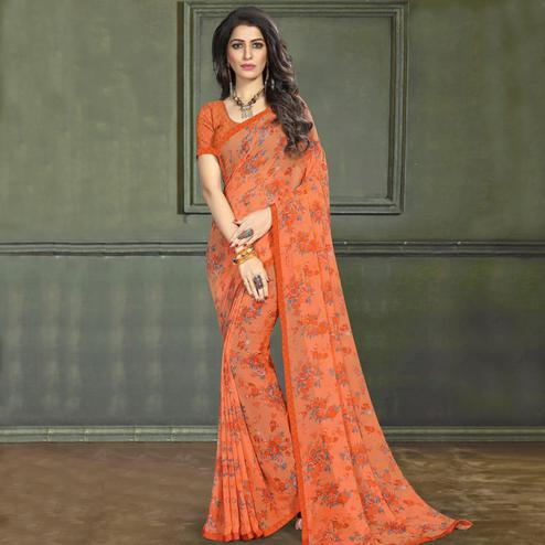 Glowing Orange Colored Casual Wear Printed Georgette Saree