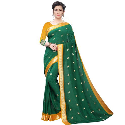 Desirable Green Colored Festive Wear Woven Vichitra Silk Saree
