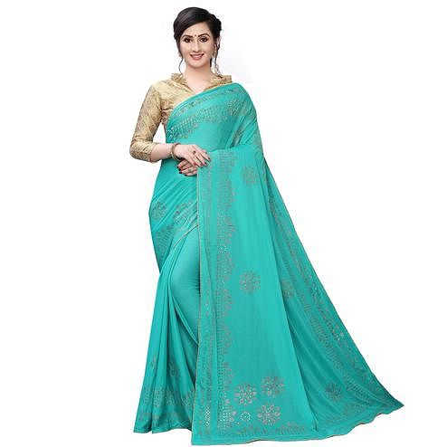 Ravishing Sea Green Colored Partywear Embelished Lycra Blend Saree