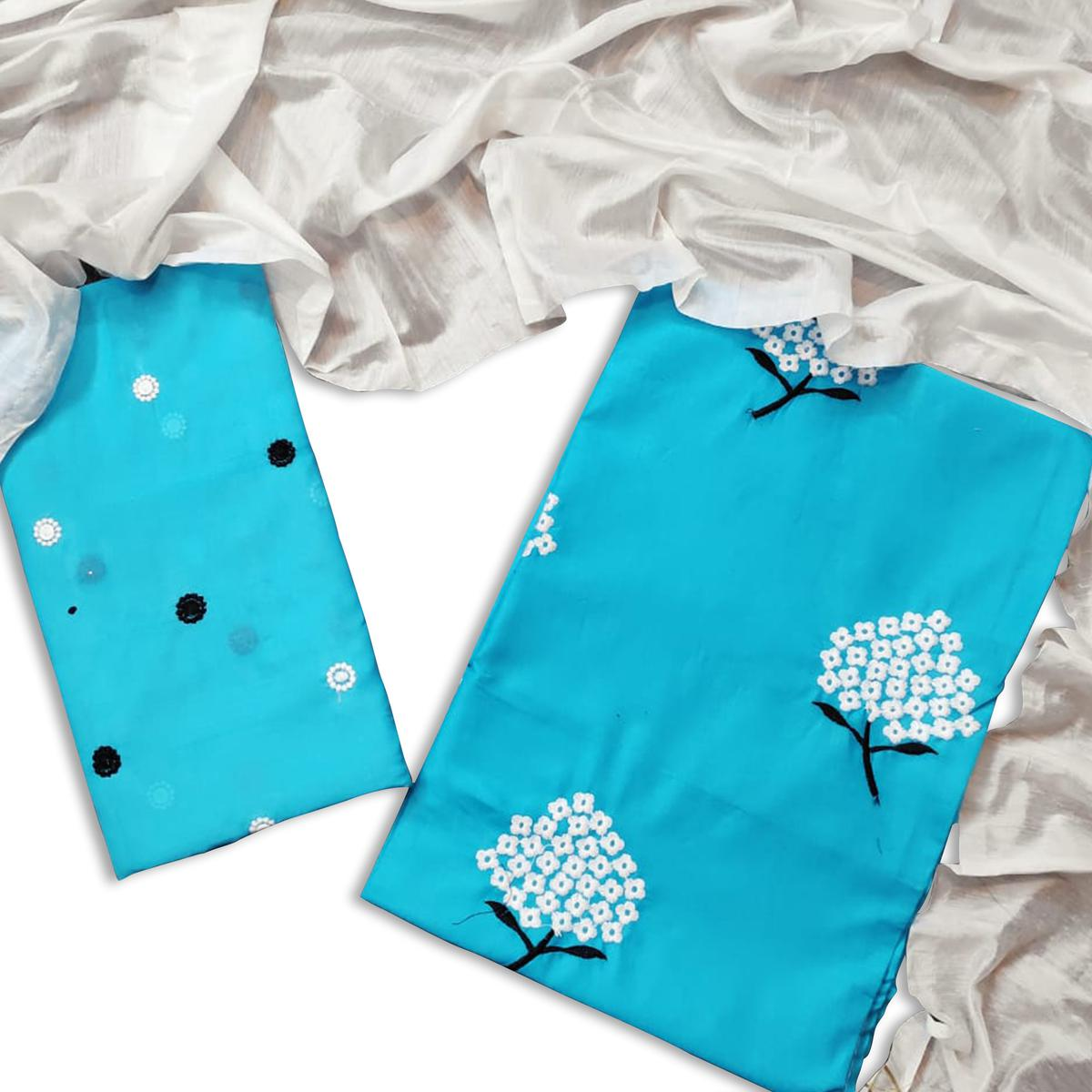 Engrossing Blue Colored Casual Wear Embroidered Cotton Dress Material