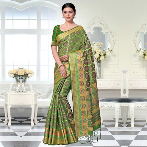 Gleaming Green Colored Festive Wear Woven Art Silk Saree With Tassels