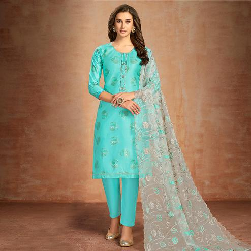 Staring Turquoise Blue Colored Partywear Embroidered Pure Cotton Dress Material