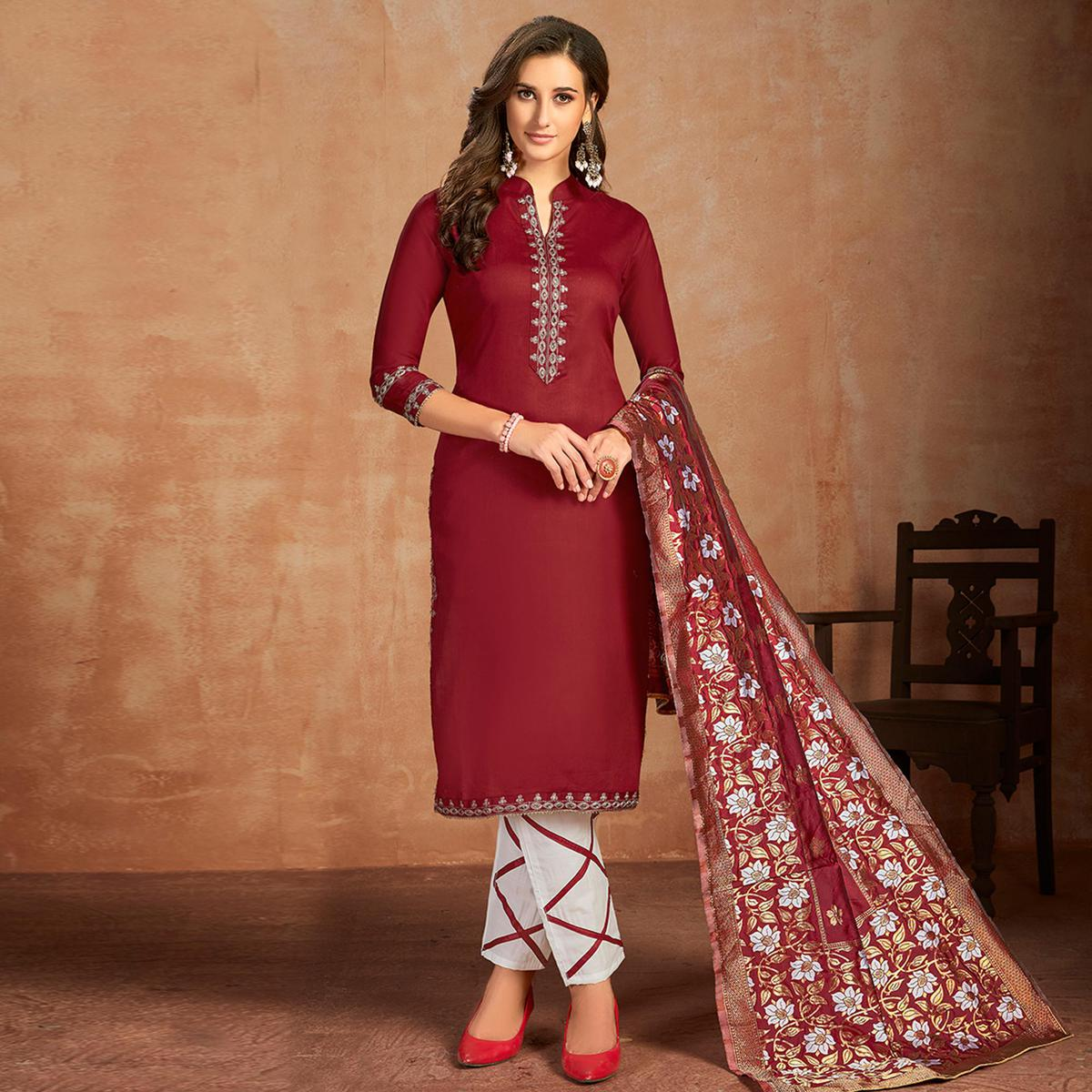 Stunning Maroon Colored Partywear Embroidered Pure Cotton Dress Material