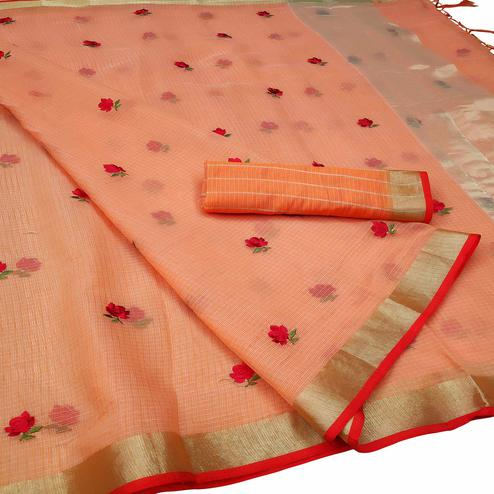 Lovely Dark Peach Colored Party Wear Floral Embroidered Silk Saree With Tassels