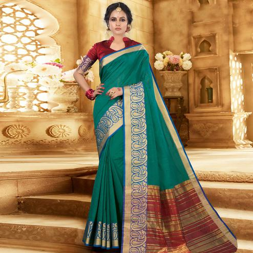Gorgeous Turquoise Green Colored Festive Wear Woven Khadi Silk Saree