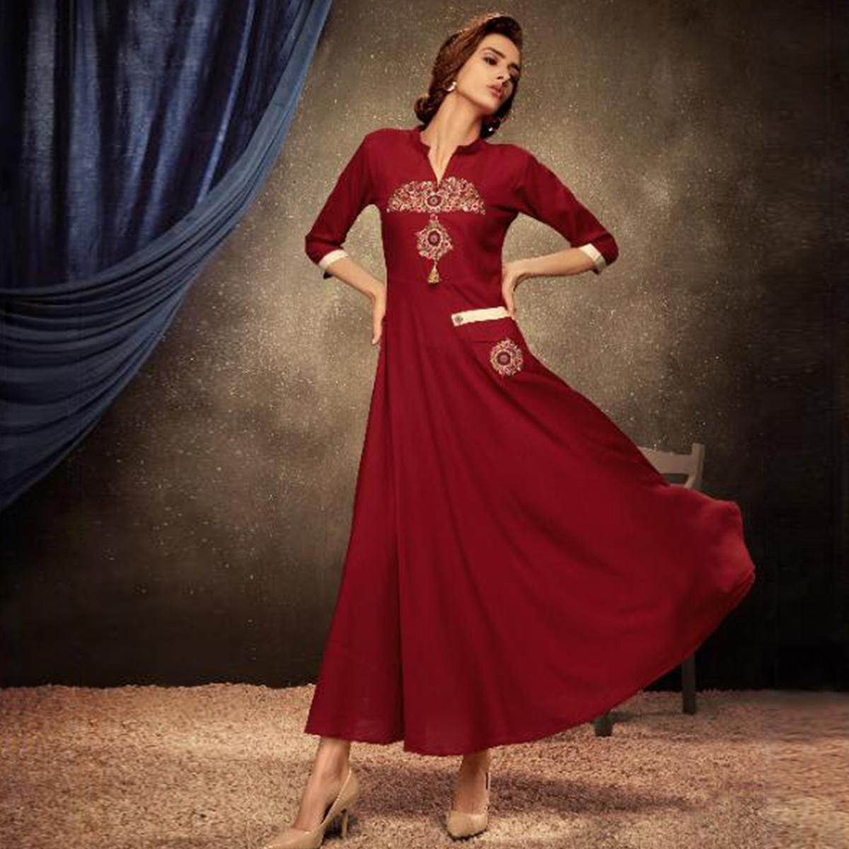 Staring Red Colored Partywear Embroidered Heavy Rayon Long Kurti