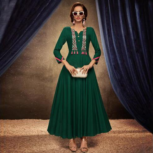 Surpassing Green Colored Partywear Embroidered Heavy Rayon Long Kurti
