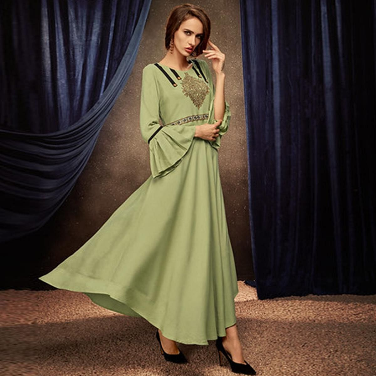 Breathtaking Pista Green Colored Partywear Embroidered Rayon Long Kurti