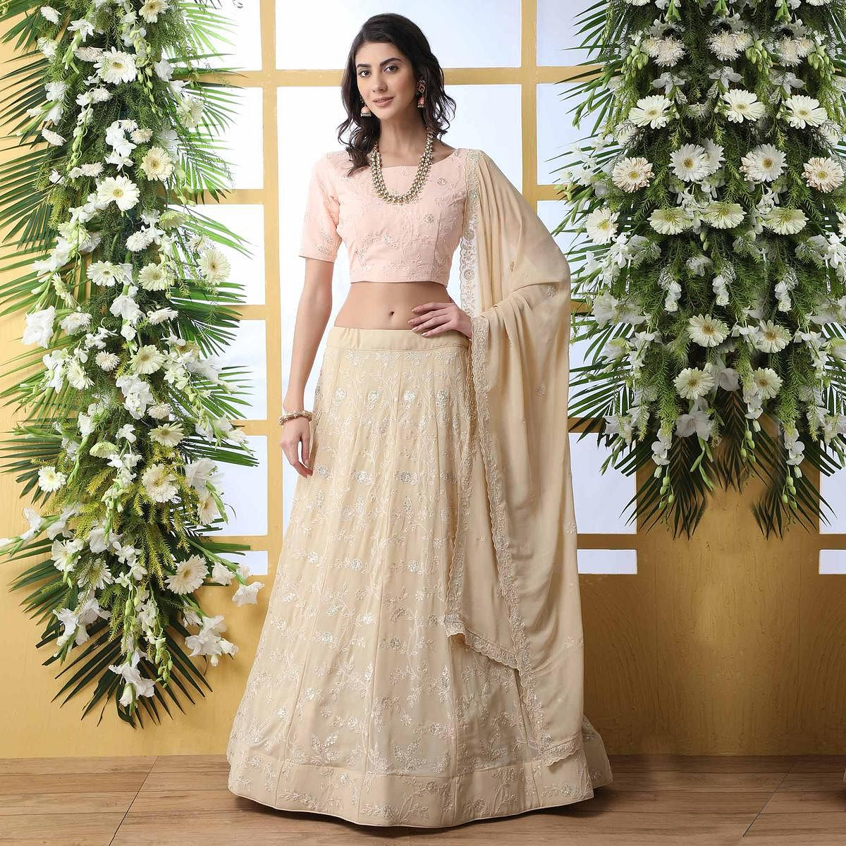 Entrancing Beige Colored Party Wear Embroidered Georgette Legenga Choli