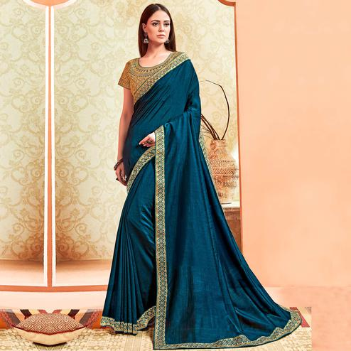 Arresting Teal Blue Colored Party Wear Embroidered Art Silk Saree With Stitched Blouse
