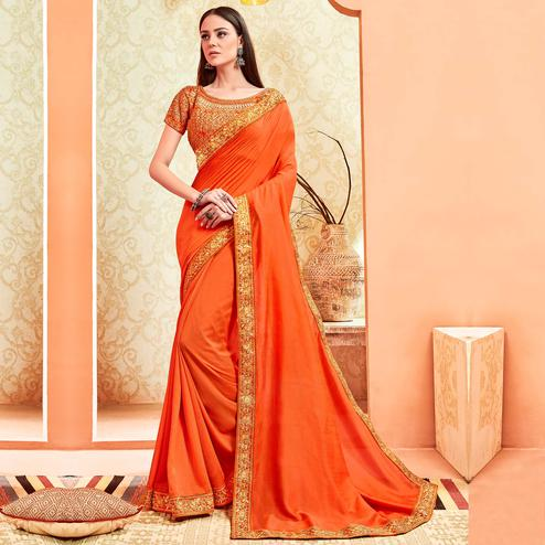 Radiant Orange Colored Party Wear Embroidered Art Silk Saree With Stitched Blouse