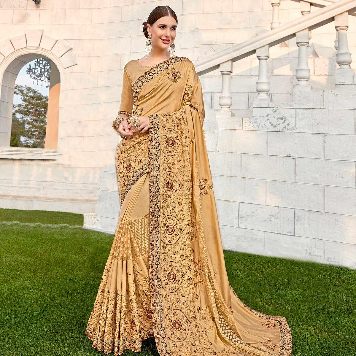 Preferable Beige Colored Party wear Embroidered Brasso Saree