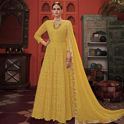 Ideal Yellow Colored Partywear Embroidered Faux Georgette-Net Anarkali Suit