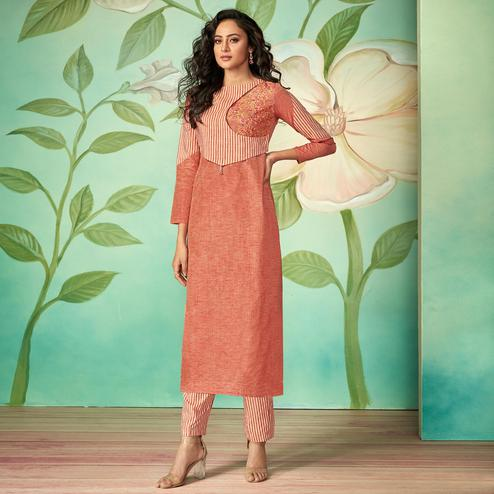 Flirty Peach Colored Party Wear Embroidered Cotton Silk Kurti-Pant Set