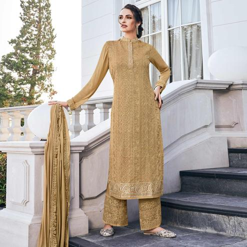 Beautiful Beige Colored Partywear Embroidered Georgette Palazzo Suit