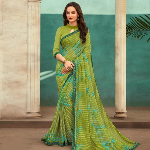 Engrossing Green Colored Casual Wear Printed Chiffon Saree